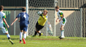 Todd Jewell makes a diving save. Photo by Michael Dill Photography. www.michaeldillphotography.com