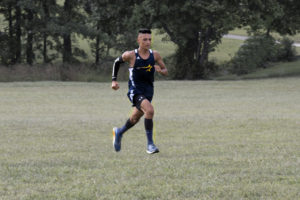Jonathan Torres in stride at a cross country event.  Photo by Jairo Torres.