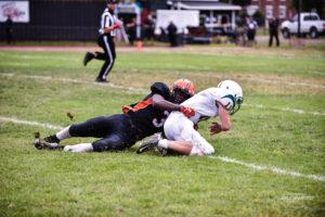 Reidgee Dimanche sacks the quarterback. Photo by Michael A. Sabo