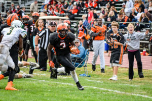 Reidgee Dimanche takes off around the corner for a touchdown. Photo by Michael A. Sabo