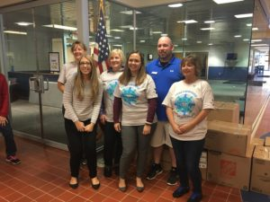 The Hamilton Area YMCA Togetherhood service committee . Photo courtesy of the Hamilton Area YMCA